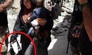 Rợn người hình ảnh mẹ IS ôm con đánh bom tự sát