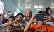 Hải quân tàu sân bay Mỹ cháy hết mình với trẻ em da cam