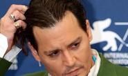 Cướp biển Johnny Depp dàn xếp êm vụ kiện 25 triệu USD