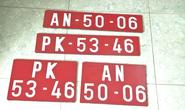 Ô tô chở thuốc lá lậu thủ' hàng loạt biển số đỏ giả