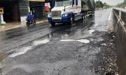Mặt đường Quốc lộ 1 lộ nhiều ổ voi, ổ gà sau mưa