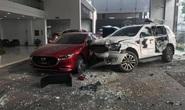 Nữ tài xế điều khiển xế hộp tông trúng người đi đường rồi lao thẳng vào showroom ôtô