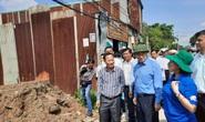 Bí thư Thành uỷ TP HCM Nguyễn Thiện Nhân đang làm việc với Bình Chánh về xây dựng nhà không phép