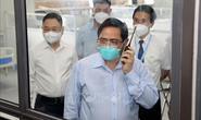Thủ tướng Phạm Minh Chính kiểm tra đột xuất các điểm nóng về dịch Covid-19 ở Hà Nội
