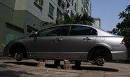 Hà Nội: Lại tháo bánh ô tô, bẻ gương chiếu hậu