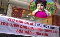 Sau Thu Minh, Thái Thùy Linh bị treo băng rôn đòi nợ