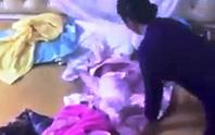 Người giúp việc nói lý do tra tấn bé 2 tháng tuổi