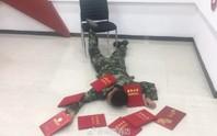 """Trung Quốc: Bị phạt tiền vì chụp ảnh """"ngã sấp mặt"""""""