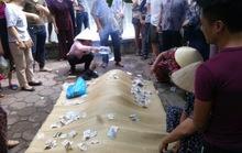 Thanh niên vung tiền cho mọi người rồi từ từ bước xuống hồ Xã Đàn tự tử