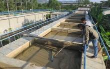 Dùng nước sông ô nhiễm