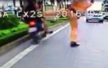 Bị CSGT chặn bắt, người vi phạm lao vào dải phân cách đường