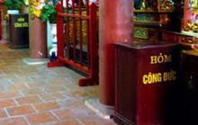 Cảnh sát mật phục bảo vệ hòm công đức đền chùa