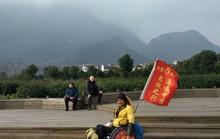 Ngồi xe lăn đi khắp Trung Quốc suốt 2 năm