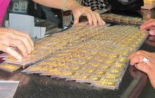 """Mỗi lượng vàng SJC """"bốc hơi"""" gần nửa triệu đồng"""