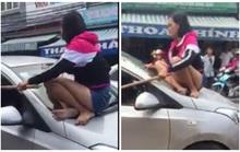 Vợ trèo lên nóc xe đánh ghen khi chồng ngoại tình với bạn thân
