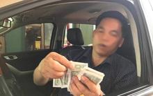 Dùng tiền lẻ 500-2.000 đồng để phản đối trạm thu phí Cầu Rác
