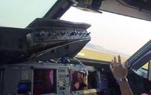 Máy bay vỡ kính buồng lái trên không, phi công bị cứa mặt