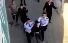 Trung Quốc: Bị truy nã, lái xe vào đồn cảnh sát đâm chết 2 người