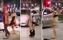Cãi nhau với tài xế taxi, nữ hành khách bất ngờ cởi phăng váy áo