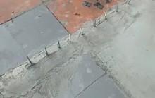 Đập bỏ hàng đinh nhọn nguy hiểm gắn trên vỉa hè trước nhà