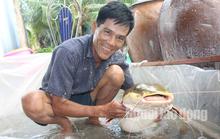 """Lão nông Bạc Liêu sở hữu """"thủy quái"""" vùng Amazon nặng 15 kg"""