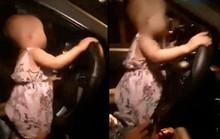 Clip bé gái khoảng 2 tuổi cầm vôlăng ôtô chạy băng băng trên quốc lộ
