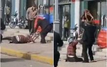 Trung Quốc: Người đi đường đứng xem nạn nhân chết trong vụ bạo lực gia đình