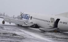 Càng bị lỗi, máy bay nằm sấp bụng trên cánh đồng tuyết ở Nga