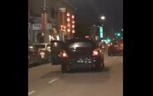 Cãi nhau trên đường, chồng đẩy vợ rơi khỏi xe hơi đang chạy