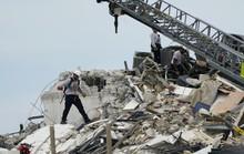 Vụ sập tòa nhà 12 tầng ở Mỹ: Còn 99 người mất tích