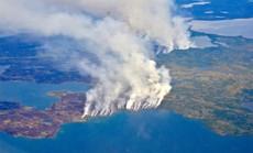 """Bắc Cực bùng cháy, đe dọa mở nắp """"mộ băng"""" cổ đầy khí độc"""
