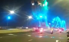 CLIP: Tài xế Mercedes dừng xe giữa cầu Rồng, cùng bạn gái chụp ảnh sống ảo