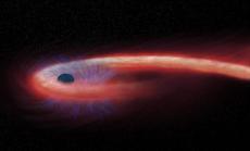 """Kinh hãi ngôi sao hình... sợi mì, quấn chặt lỗ đen """"quái vật"""""""