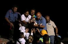 Anh 11 tuổi cứu em trai trong động đất