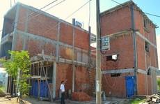 Chúng tôi bị hàng xóm ép giá vì lỡ lấn đất khi xây nhà