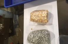 Phát hiện nhiều viên nén khả nghi trong hũ đồ ăn ký gửi tại Tân Sơn Nhất