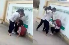Xôn xao clip nữ sinh lớp 8 bị đánh hội đồng trước cổng trường vì chê mẫu áo mỏng
