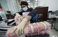 Trung Quốc khử trùng, cách ly tiền giấy để ngăn chặn Covid-19