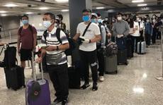 Gần 600 người Việt từ Mỹ, Singapore về nước
