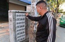 Dán quảng cáo ở cột điện có thể bị phạt đến 2 triệu đồng