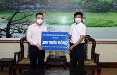 Báo Nhân Dân tặng 300 triệu đồng hỗ trợ người dân TP HCM gặp khó khăn do dịch Covid-19