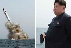 Kim Yong-un tươi cười xem phóng tên lửa đạn đạo