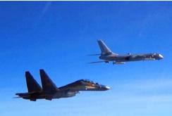 """Bản tin NLĐ ngày 10-2: Máy bay quân sự Mỹ - Trung """"chạm trán"""" trên biển Đông"""