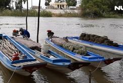 Ghi nhanh: Dân nghèo miền Tây mưu sinh mùa nước nổi