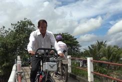 Độc đáo xe đạp có động cơ máy cắt cỏ
