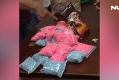 Cốp xe chứa 13.000 viên thuốc lắc, 0,5kg ma túy
